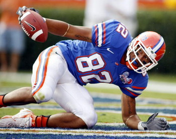 GAINESVILLE, FL - SEPTEMBER 30:  Florida Gators receiver Louis Murphy #82 scores a touchdow  against the Louisiana State Tigers at Ben Hill Griffin Stadium on October 7, 2006 in Gainesville, Florida.  (Photo by Marc Serota/Getty Images)