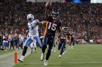 DENVER - NOVEMBER 19:  Wide receiver Brandon Marshall #15 of the Denver Broncos begins to celebrate as he beats safety Michael Griffin #33 of the Tennessee Titans to the enzone as he goes 41 yards on a reception from Jay Cutler #6 of the Denver Broncos fo