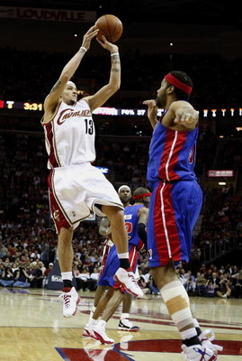 CLEVELAND - APRIL 21: Delonte West #13 of the Cleveland Cavaliers attempts a shot over Rasheed Wallace #30 of the Detroit Pistons in Game Two of the Eastern Conference Quarterfinals during the 2009 NBA Playoffs at Quicken Loans Arena on April 21, 2009 in