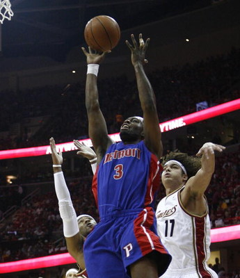 CLEVELAND - APRIL 18:   Rodney Stuckey #3 of the Detroit Pistons shoots over Mo Williams #2 and Anderson Varejao #17 of the Cleveland Cavaliers during Game One of the Eastern Conference Quarterfinals during the 2009 NBA Playoffs at Quicken Loans Arena on