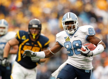CHARLOTTE, NC - DECEMBER 27:  Hakeem Nicks #88 of the North Carolina Tar Heels runs with the ball against the West Virginia Mountaineers during the Meineke Car Care Bowl on December 27, 2008 at Bank of America Stadium in Charlotte, North Carolina.  (Photo