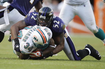 MIAMI - JANUARY 4:  Ray Lewis #52 of the Baltimore Ravens tackles Ricky Williams #34 of the Miami Dolphins during an AFC Wild Card playoff game on January 4, 2009 at Dolphin Stadium in Miami, Florida. (Photo by Gregory Shamus/Getty Images)