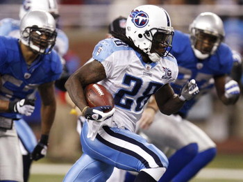 DETROIT, MI - NOVEMBER 27:  Chris Johnson #28 of the Tennessee Titans runs for a first quarter touchdown while playing the Detroit Lions on November 27, 2008 at Ford Field in Detroit, Michigan.  (Photo by Gregory Shamus/Getty Images)