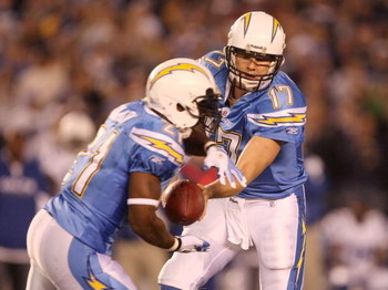 SAN DIEGO - JANUARY 03:  Philip Rivers #17 of the San Diego Chargers hands off the ball to LaDainian Tomlinson #21 during their game against the Indianapolis Colts in the AFC Wild Card Game on January 3, 2009 at Qualcomm Stadium in San Diego, California.