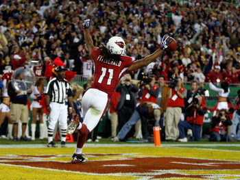 TAMPA, FL - FEBRUARY 01:  Larry Fitzgerald #11 of the Arizona Cardinals celebrates after scoring a touchdown in the fourth quarter against the Pittsburgh Steelers during Super Bowl XLIII on February 1, 2009 at Raymond James Stadium in Tampa, Florida.  (Ph