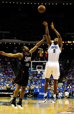 ORLANDO, FL - APRIL 19:  Rashard Lewis #9 of the Orlando Magic shoots over Willie Green #33 of the Philadelphia 76ers in Game One of the Eastern Conference Quarterfinals during the 2009 NBA Playoffs at Amway Arena on April 19, 2009 in Orlando, Florida.  N