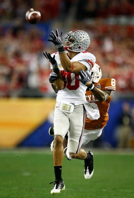 GLENDALE, AZ - JANUARY 05:  Wide receiver Brian Robiskie #80 of the Ohio State Buckeyes is unable to catch a pass under pressure from Chykie Brown #8 of the Texas Longhorns during the first quarter of the Tostitos Fiesta Bowl Game on January 5, 2009 at Un