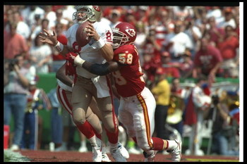 11 Sep 1994:  Linebacker Derrick Thomas of the Kansas City Chiefs sacks San Francisco 49ers quarterback Steve Young during a game at Arrowhead Stadium in Kansas City, Missouri.  The Chiefs won the game, 24-17. Mandatory Credit: Mike Powell  /Allsport