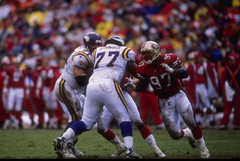 7 Dec 1997:  Bryant Young #97 of the San Francisco 49ers runs around Korey Stringer #77 of the Minnesota Vikings during a game at 3Com Park in San Francisco, California. The 49ers defeated the Vikings 28-17. Mandatory Credit: Otto Greule Jr.  /Allsport