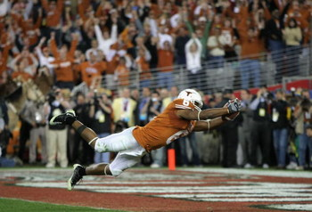 GLENDALE, AZ - JANUARY 05:  Wide receiver Quan Cosby #6 of the Texas Longhorns dives into the endzone after a 26 yard touchdown reception against the Ohio State Buckeyes during the Tostitos Fiesta Bowl Game on January 5, 2009 at University of Phoenix Stad