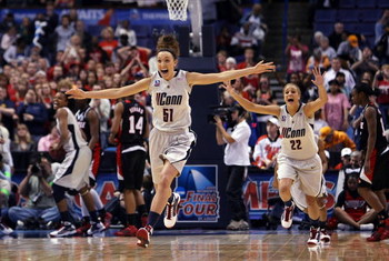 ST. LOUIS - APRIL 07:   Cassie Kerns #51 and Meghan Gardler #22 of the Connecticut Huskies celebrate the win at the buzzer during the NCAA Women's Final Four Championship game against the Louisville Cardinals at the Scottrade Center on April 7, 2009 in St