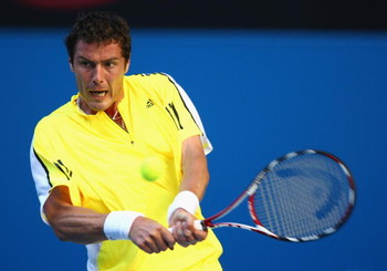 MELBOURNE, AUSTRALIA - JANUARY 19:  Marat Safin of Russia plays a backhand in his first round match against Ivan Navarro of Spain during day one of the 2009 Australian Open at Melbourne Park on January 19, 2009 in Melbourne, Australia.  (Photo by Clive Br