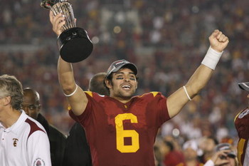 PASADENA, CA - JANUARY 1:  Mark Sanchez #6 of the USC Trojans rejoices as he holds the Rose Bowl Trophy after the game against the Penn State Nittany Lions on January 1, 2009 at the Rose Bowl in Pasadena, California.  USC won 38-24.  (Photo by Jeff Golden