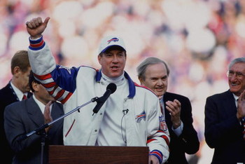 18 Nov 2001:  Quarterback Jim Kelly #12 of the Buffalo Bills speaking at the podium with President Ralph Wilson Jr. during Jim Kelly's Retirement Ceremony before the game against the Seattle Seahawks at the Ralph Wilson Stadium in Orchard Park, New York.