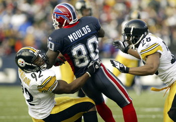 ORCHARD PARK, NY - JANUARY 2: James Harrison #92 and Chris Hope #28 of the Pittsburgh Steelers bring down Eric Moulds #80 of the Buffalo Bills on January 2, 2004 at Ralph Wilson Stadium in Orchard Park, New York. (Photo by Rick Stewart/Getty Images)