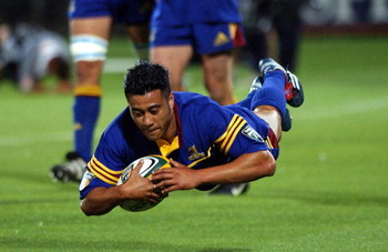 DUNEDIN, NEW ZEALAND - MARCH 02:  Romi Ropati gets the Highlanders 5th try during the Super 12 Rugby game, Sharks vs Highlanders played at Carisbrook, Saturday. The Highlanders won 455.  (Photo by Dean Purcell/Getty Images)