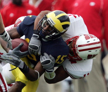 ANN ARBOR, MI - SEPTEMBER 23:  Steve Breaston #15 of the Michigan Wolverines is tackled by DeAndre Levy #11 of the Wisconsin Badgers on September 23, 2006 at Michigan Stadium in Ann Arbor, Michigan. Michigan defeated Wisconsin 27-13.  (Photo by Jonathan D