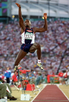 GEORGIA, US - JULY 29:  Carl Lewis of the USA makes the winning Long Jump 8.50ft during the 1996 Olympic Games at the Olympic Stadium July 29, 1996 in Atlanta, Georgia. (Photo by Mike Powell/Getty Images)