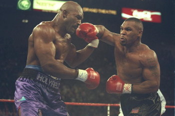 9 Nov 1996:  Mike Tyson (right) throws a right hook at Evander Holyfield during their bout at the MGM Grand Garden in Las Vegas, Nevada.  Holyfield won the bout by way of TKO in the 11th round.  Mandatory Credit: Al Bello  /Allsport