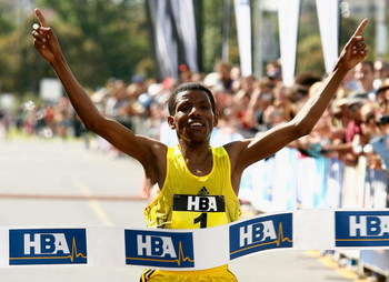 MELBOURNE, AUSTRALIA - NOVEMBER 30:  Haile Gebreselassie of Ethiopia crosses the line to win the Great Australian Run 2008 held at Albert Park on November 30, 2008 in Melbourne, Australia.   (Photo by Quinn Rooney/Getty Images)