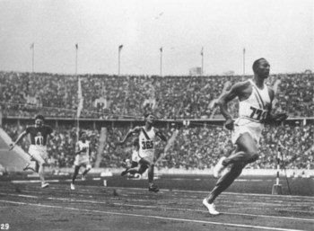 2 Aug 1936:  Jesse Owens of the USA crosses the finishing line during the 100 metres event at the 1936 Olympic Games in Berlin. Owens won the gold medal with a time of 10.3 seconds. \ Mandatory Credit: IOC Olympic Museum  /Allsport