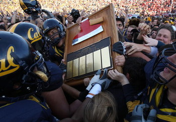 BERKELEY, CA - NOVEMBER 22:  Members of the California Golden Bears run with 'The Axe' after defeating the Stanford Cardinal during an NCAA football game on November 22, 2008 at Memorial Stadium in Berkeley, California.  (Photo by Jed Jacobsohn/Getty Imag