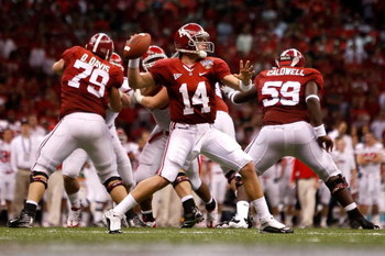 NEW ORLEANS - JANUARY 02:  Quarterback John Parker Wilson #14 of the Alabama Crimson Tide throws the ball in the fourth quarter while taking on the Utah Utes during the 75th Allstate Sugar Bowl at the Louisiana Superdome on January 2, 2009 in New Orleans,