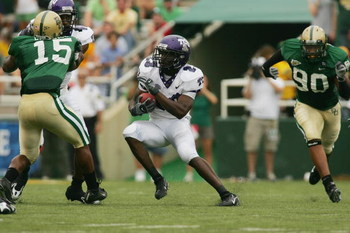 WACO, TX - SEPTEMBER 3:  Running back Aaron Brown #23 of the TCU Horned Frogs runs with the ball during the game against the Baylor Bears on September 3, 2006 at Floyd Casey Stadium in Waco, Texas. TCU defeated Baylor 17-7.  (Photo by Ronald Martinez/Gett