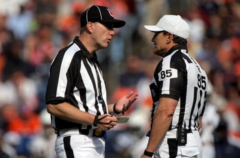 DENVER - SEPTEMBER 14:  Referee Ed Hochuli (R) confers with umpire Tony Michalek as they oversee the action between the San Diego Chargers and the Denver Broncos during NFL action at Invesco Field at Mile High on September 14, 2008 in Denver, Colorado. Th