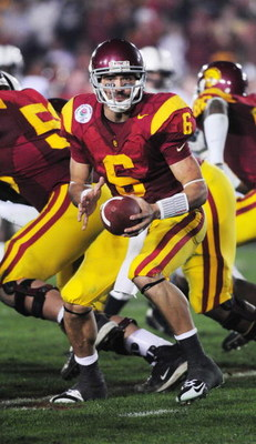 PASADENA, CA - JANUARY 01: Quarterback Mark Sanchez #6 of the USC Trojans to hand the ball off during the 95th Rose Bowl Game presented by Citi against the Penn State Nittany Lions at the Rose Bowl on January 1, 2009 in Pasadena, California. The Trojans d