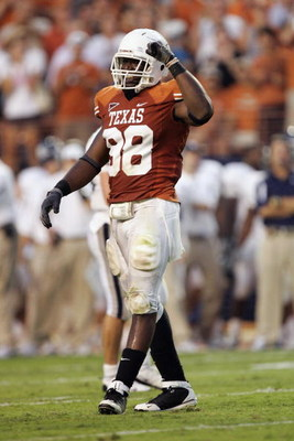 AUSTIN, TX - SEPTEMBER 20:  Brian Orakpo #98 of the Texas Longhorns celebrates a play during the game against the Rice Owls on September 20, 2008 at Darrell K Royal-Texas Memorial Stadium in Austin, Texas. Texas won 52-10. (Photo by Brian Bahr/Getty Image