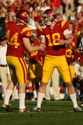 PASADENA, CA - JANUARY 01:  Greg Woidneck #44 and David Beuhler #18 of the USC Trojans celebrate a field goal against the Penn State Nittany Lions during the 95th Rose Bowl Game presented by Citi on January 1, 2009 at the Rose Bowl in Pasadena, California