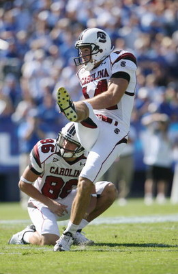 LEXINGTON, KY - OCTOBER 11:  Punter Ryan Succop #14 of the South Carolina Gamecocks kicks as teammate Stephen Flint #86 looks on against the Kentucky Wildcats during the game at Commonwealth Stadium on October 11, 2008 in Lexington, Kentucky. South Caroli