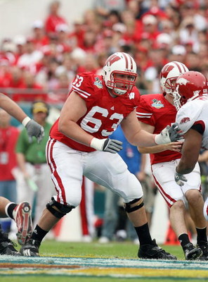 ORLANDO, FL - JANUARY 01:  Kraig Urbik #63 of the Wisconsin Badgers moves on the field against the Arkansas Razorbacks in the Capitol One Bowl at Florida Citrus Bowl on January 1, 2007 in Orlando, Florida. (Photo by Doug Benc/Getty Images)