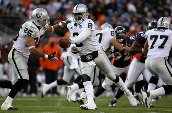 DENVER - NOVEMBER 23:  Quarterback JaMarcus Russell #2 of the Oakland Raiders hands the ball off to Justin Fargas #25 against the Denver Broncos during week 12 NFL action at Invesco Field at Mile High on November 23, 2008 in Denver, Colorado. The Raiders