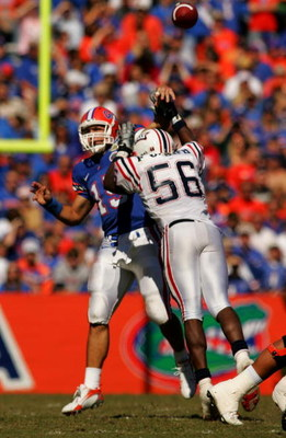GAINESVILLE, FL - NOVEMBER 17:  Tim Tebow #15 of the Florida Gators throws a pass under pressure from Frantz Joseph #56 of the FAU Owls at Ben Hill Griffin Stadium on November 17, 2007 in Gainesville, Florida.  The Gators won the game 59-20.  (Photo by Sa