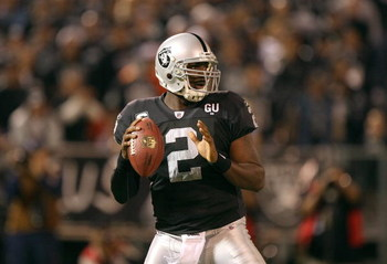 OAKLAND, CA - SEPTEMBER 8:  Quarterback JaMarcus Russell #2 of the Oakland Raiders looks to make a pass play during the NFL game against the Denver Broncos on September 8, 2008 at McAfee Coliseum in Oakland, California. The Broncos defeated the Raiders 41