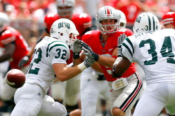 COLUMBUS, OH - SEPTEMBER 06:  Receiver Brian Hartline #9 of the Ohio State Buckeyes fails to pull in this reception against Lee Renfro #32 and Michael Mitchell #34 of the Ohio Bobcats during the game at Ohio Stadium on September 6, 2008 in Columbus, Ohio.