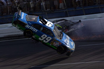 TALLADEGA, AL - APRIL 26:  Carl Edwards, driver of the #99 Claritin Ford goes airborne as Ryan Newman, driver of the #34 Stewart-Haas Racing Chevrolet hits the wall at the end of the NASCAR Sprint Cup Series Aaron's 499 at Talladega Superspeedway on April