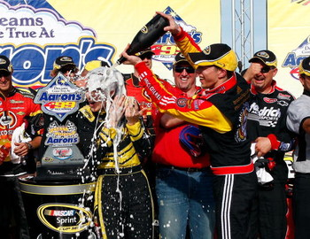 TALLADEGA, AL - APRIL 26:  Brad Keselowski, driver of the #09 Miccosukee Chevrolet, celebrates in victory lane after winning the NASCAR Sprint Cup Series Aaron's 499 at Talladega Superspeedway on April 26, 2009 in Talladega, Alabama.  (Photo by John Harre