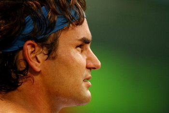 KEY BISCAYNE, FL - MARCH 31:  Roger Federer of Switzerland looks on against Taylor Dent during day nine of the Sony Ericsson Open at the Crandon Park Tennis Center on March 31, 2009 in Key Biscayne, Florida.  (Photo by Al Bello/Getty Images)