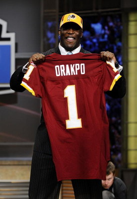 NEW YORK - APRIL 25:   Washington Redskins #13 draft pick Brian Orakpo poses for photographers at Radio City Music Hall for the 2009 NFL Draft on April 25, 2009 in New York City  (Photo by Jeff Zelevansky/Getty Images)