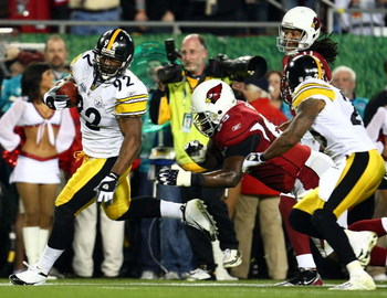 TAMPA, FL - FEBRUARY 01:  James Harrison #92 of the Pittsburgh Steelers scores a 100-yard interception for a touchdown in the second quarter against the Arizona Cardinals during Super Bowl XLIII on February 1, 2009 at Raymond James Stadium in Tampa, Flori