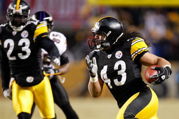 PITTSBURGH - JANUARY 18:  Safety Troy Polamalu #43 of the Pittsburgh Steelers returns an interception 40 yards for a touchdown against the Baltimore Ravens during the fourth quarter of the AFC championship game on January 18, 2009 at Heinz Field in Pittsb
