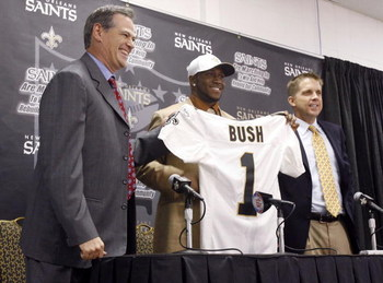 NEW ORLEANS - APRIL 29:  (L-R) General Manager Mickey Loomis, 2006 second overall NFL draft pick Reggie Bush, and head coach Sean Payton of the New Orleans Saints pose together during a press conference on April 29, 2006 in New Orleans, Louisiana.  (Photo