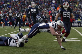 ORCHARD PARK, NY - DECEMBER 28:  Heath Evans #44 of the New England Patriots dives for extra yardage during the game against the Buffalo Bills on December 28, 2008 at Ralph Wilson Stadium in Orchard Park, New York. (Photo by Rick Stewart/Getty Images)