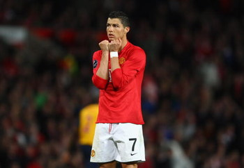 MANCHESTER, ENGLAND - APRIL 29:  Cristiano Ronaldo of Manchester United reacts to a missed chance during the UEFA Champions League Semi Final First Leg match between Manchester United and Arsenal at Old Trafford on April 29, 2009 in Manchester, England.