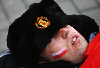 MOSCOW - MAY 21:  A Manchester United fan sleeps  prior to the late kick off during the UEFA Champions League Final match between Manchester United and Chelsea at the Luzhniki Stadium on May 21, 2008 in Moscow, Russia.  (Photo by Jamie McDonald/Getty Imag