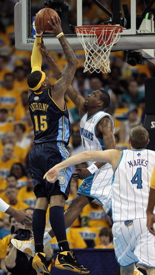 NEW ORLEANS - APRIL 25:  Carmelo Anthony #15 of the Denver Nuggets goes to the basket against Rasual Butler #45 and Sean Marks #4 of the New Orleans Hornets during Game Three of the Western Conference Quarterfinals during the 2009 NBA Playoffs at New Orle