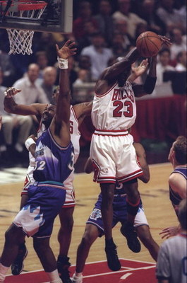 10 Jun 1998:  Michael Jordan #23 of the Chicago Bulls in action against Karl Malone #32 of the Utah Jazz during the NBA Finals Game 4 at the United Center in Chicago, Illinois.  The Bulls defeated the Jazz 86-82. Mandatory Credit: Jonathan Daniel  /Allspo